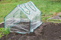 Mini greenhouse frame collapsible greenhouses installed in the vegetable garden Stock Images