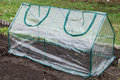 Mini greenhouse frame collapsible greenhouses installed in the vegetable garden Royalty Free Stock Photography