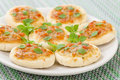 Mini margherita pizzas small with tomato sauce cheese and basil topping party food Royalty Free Stock Image