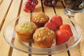 Mini muffins and strawberries a plate of with Royalty Free Stock Photo