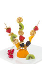 Mini pancake with cut fruits on skewers, isolated Royalty Free Stock Photography