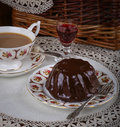 Mini pound cake chocolate hazelnut tea lace liquor on old pictures cup side plate on and red wine Stock Image