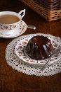Mini pound cake chocolate hazelnut tea lace on old pictures cup and side plate on Royalty Free Stock Photos