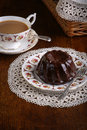 Mini pound cake chocolate hazelnut tea lace on old pictures cup and side plate on Royalty Free Stock Image