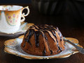 Mini pound cake hazelnut cake with chocolate drizzle old pictures coffee cup and side plate Stock Photography