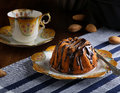 Mini pound cake hazelnut cake with chocolate drizzle old pictures coffee cup side plate and almonds Royalty Free Stock Image