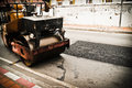 Mini road rollers during asphalt paving works cover repair by machines Stock Image