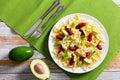 Mini salami Bowtie Pasta warm salad with avocado slices Royalty Free Stock Photo