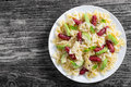 Mini salami Bowtie Pasta warm salad sprinkled with grated parmes Royalty Free Stock Photo