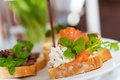 Mini sandwiches with smoked salmon and minty cream cheese Stock Photo