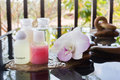 Mini set of bubble bath and shower liquid gel with orchid flower flowers on pebble water Royalty Free Stock Image