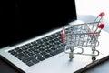 Mini Shopping Cart On Laptop Royalty Free Stock Photo