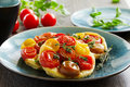 Mini tarts with colored tomatoes Stock Image