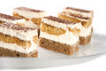 Mini tiramisu cakes on a glass plate Royalty Free Stock Photo