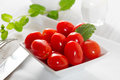 Mini tomatoes on a platter Royalty Free Stock Photos