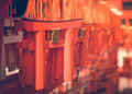 Mini Torii gate in Kyoto, Japan. Japanese wording means Fushimi Royalty Free Stock Photo