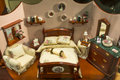 Miniature bedroom a in a classic setting Stock Images