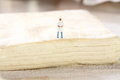 Miniature chef pastry a standing on block of puff Royalty Free Stock Image
