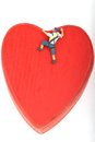 Miniature of climber scaling a red heart Royalty Free Stock Photo