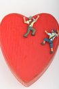 Miniature of climbers scaling a red heart Royalty Free Stock Photo