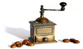 Miniature coffee grinder bronze antique manual with shadows Stock Photos