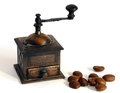 Miniature coffee grinder bronze antique manual with shadows Royalty Free Stock Image