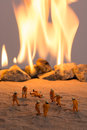 Miniature firemen at work a real fire scene Royalty Free Stock Photography