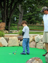 Miniature Golf Family Stock Photography