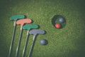 Miniature golf hole with bat and ball Royalty Free Stock Photo