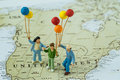 Miniature happy family holding balloons standing on United State Royalty Free Stock Photo