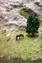 Miniature horse plastic toy model. Herd of horses grazing in the meadow on the mountain hillside. Royalty Free Stock Photo