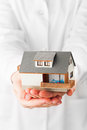 Miniature house in hands Royalty Free Stock Photo