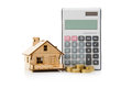 Miniature house model with calculator and gold coins Stock Image