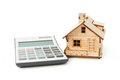 Miniature house model with calculator isolated on white background Royalty Free Stock Photo