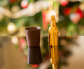 Miniature liqueur bottle by chocolate cup Royalty Free Stock Photo