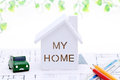 Miniature model of house on blueprints Royalty Free Stock Photo
