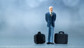 Miniature people a businessman waiting in the airport lobby for billboard informations Royalty Free Stock Images