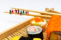 Miniature peoples with sushi sit by lunch Stock Photo
