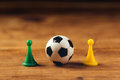 Miniature plastic soccer ball on wooden table Royalty Free Stock Photo