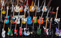 Miniature replicas of guitars mythical since outdoor market with handmade reproductions famous made in polychrome wood Stock Photos