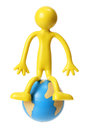 Miniature Rubber Figure with Globe Stock Photography