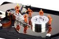 Miniature technicians work on hard drive Royalty Free Stock Photos