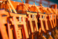 Miniature torii gates souvenir at fushimi inari shrine in kyoto japan Stock Photos