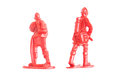 Miniature toy fire fighter backside on white background Royalty Free Stock Photo