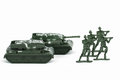 Miniature toy tank and soldiers attacker isolated on white background Stock Photos