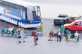 Miniature travellers at a bus station Royalty Free Stock Photography