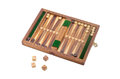 Miniature travelling backgammon set on a light background Royalty Free Stock Photo