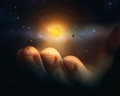 Miniature universe a rests on the finger tips of a hand Stock Image