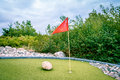 Minigolf cource large with a flag in the hole Stock Images