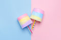 Minimal style. Multicolored Cotton candy. Pastel blue and pink background Royalty Free Stock Photo